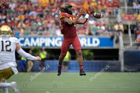 Iowa State linebacker Marcel Spears Jr. (42) nearly intercepts a pass thrown by Notre Dame quarterback Ian Book (12) during the first half of the Camping World Bowl NCAA college football game, in Orlando, Fla