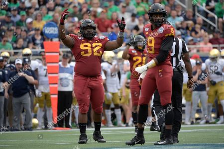Iowa State defensive lineman Jamahl Johnson (92) and linebacker Will McDonald (9) set up for a play at the line of scrimmage during the first half of the Camping World Bowl NCAA college football game against Notre Dame, in Orlando, Fla