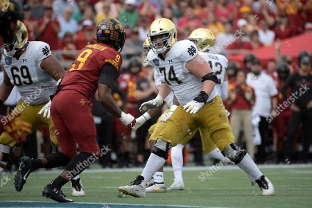 Notre Dame offensive lineman Liam Eichenberg (74) sets up to block Iowa State linebacker Will McDonald (9) during the first half of the Camping World Bowl NCAA college football game, in Orlando, Fla