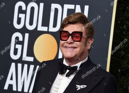 Elton John arrives at the 77th annual Golden Globe Awards at the Beverly Hilton Hotel, in Beverly Hills, Calif. Celebrities from Elton John to Chris Hemsworth have each pledged to donate a million to help aid the efforts for the engulfing wildfires in Australia