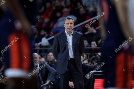 Virginia head coach Tony Bennett watches his players during the first half of an NCAA college basketball game against Boston College in Boston