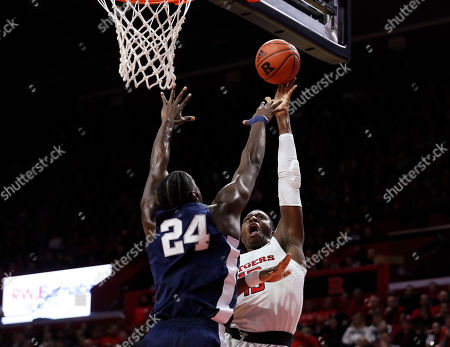 Rutgers forward Shaq Carter (13) shoots over Penn State forward Mike Watkins (24) during the first half of an NCAA college basketball game, in Piscataway, N.J