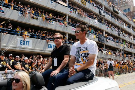 Ron Burkle, Mario Lemieux. Shows Pittsburgh Penguins owners Mario Lemieux, right, and Ron Burkle riding in the Stanley Cup victory parade in Pittsburgh