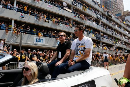 Stock Image of Ron Burkle, Mario Lemieux. Shows Pittsburgh Penguins owners Mario Lemieux, right, and Ron Burkle riding in the Stanley Cup victory parade in Pittsburgh