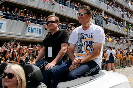 Stock Picture of Ron Burkle, Mario Lemieux. Shows Pittsburgh Penguins owners Mario Lemieux, right, and Ron Burkle riding in the Stanley Cup victory parade in Pittsburgh