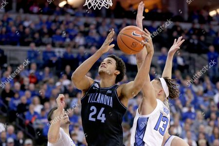 Christian Bishop, Jeremiah Robinson-Earl, Macr. Villanova's Jeremiah Robinson-Earl (24) goes to the basket past Creighton's Marcus Zegarowski, left, and Christian Bishop (13) during the first half of an NCAA college basketball game in Omaha, Neb