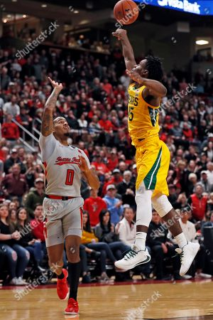 Baylor's Davion Mitchell (45) blocks the pass by Texas Tech's Kyler Edwards (0) during the first half of an NCAA college basketball game, in Lubbock, Texas