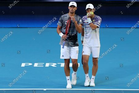 Ben McLachlan (L) and Go Soeda (R) of Japan in action during their doubles match against Rafael Nadal and Pablo Carreno Busta of Spain during day six of the ATP Cup tennis tournament at the RAC Arena in Perth, Australia, 08 January 2020.