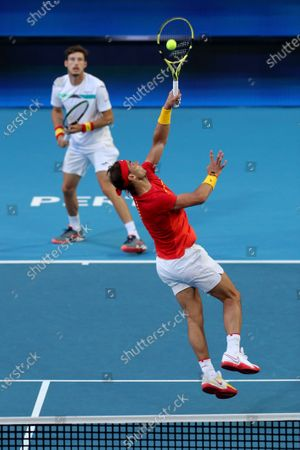 Rafael Nadal (R) and Pablo Carreno Busta (L) of Spain in action during their doubles match against Ben McLachlan and Go Soeda of Japan during day six of the ATP Cup tennis tournament at the RAC Arena in Perth, Australia, 08 January 2020.