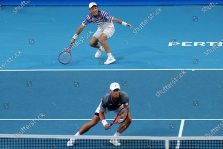 Ben McLachlan (bottom) and Go Soeda (top) of Japan in action during their doubles match against Rafael Nadal and Pablo Carreno Busta of Spain during day six of the ATP Cup tennis tournament at the RAC Arena in Perth, Australia, 08 January 2020.