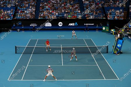 Rafael Nadal (L, top) and Pablo Carreno Busta (R, top) of Spain in action during their doubles match against Ben McLachlan (R, bottom) and Go Soeda (L, bottom) of Japan during day six of the ATP Cup tennis tournament at the RAC Arena in Perth, Australia, 08 January 2020.