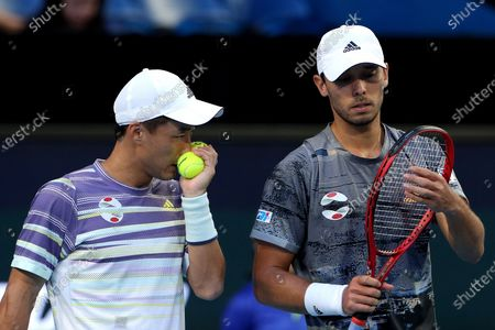 Go Soeda (L) and Ben McLachlan of Japan in action during their doubles match against Rafael Nadal and Pablo Carreno Busta of Spain during day six of the ATP Cup tennis tournament at the RAC Arena in Perth, Australia, 08 January 2020.