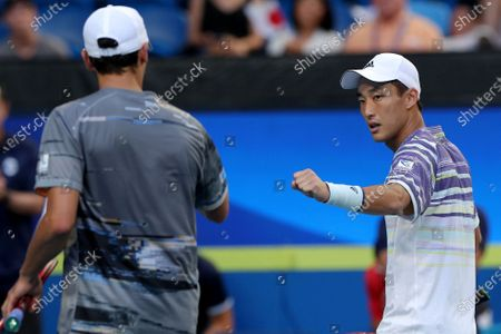 Go Soeda (R) and Ben McLachlan (L) of Japan in action during their doubles match against Rafael Nadal and Pablo Carreno Busta of Spain during day six of the ATP Cup tennis tournament at the RAC Arena in Perth, Australia, 08 January 2020.