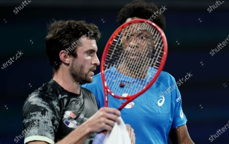 Gael Monfils (right) takes on a team captain role with Gilles Simon of France (left) after withdrawing from the match with injury during singles match against Lloyd Harris of South Africa on day 6 of the ATP Cup tennis tournament at Pat Rafter Arena in Brisbane, Australia, 08 January 2020.