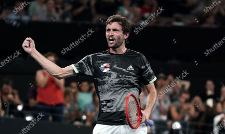 Gilles Simon of France celebrates after winning  his singles match against Lloyd Harris of South Africa on day 6 of the ATP Cup tennis tournament at Pat Rafter Arena in Brisbane, Australia, 08 January 2020.