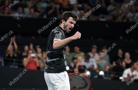 Gilles Simon of France celebrates winning his singles match against Lloyd Harris of South Africa on day six of the ATP Cup tennis tournament at Pat Rafter Arena in Brisbane, Australia, 08 January 2020.