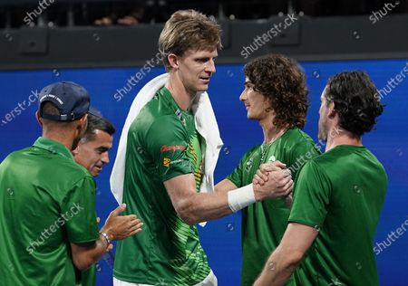 Stock Picture of Kevin Anderson of South Africa (C) celebrates with his team after defeating Benoit Paire of France on day 6 of the ATP Cup tennis tournament at Pat Rafter Arena in Brisbane, Australia, 08 January 2020.