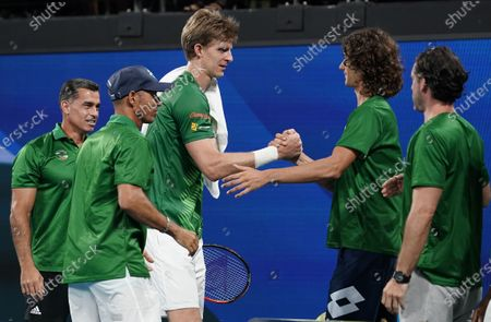 Kevin Anderson of South Africa (C) celebrates with his team after defeating Benoit Paire of France on day 6 of the ATP Cup tennis tournament at Pat Rafter Arena in Brisbane, Australia, 08 January 2020.