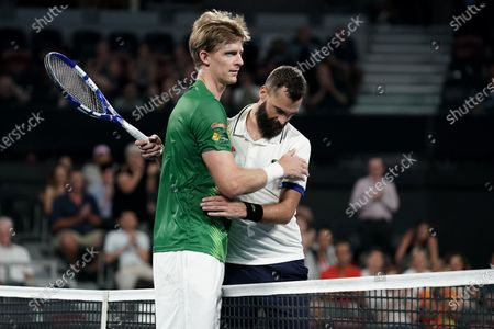 Stock Photo of Kevin Anderson of South Africa (left) after defeating Benoit Paire of Francer (right) in their singles match on day 6 of the ATP Cup tennis tournament at Pat Rafter Arena in Brisbane, Australia, 08 January 2020.