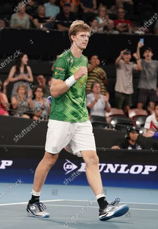 Kevin Anderson of South Africa celebrates after defeating Benoit Paire of France in their singles match on day 6 of the ATP Cup tennis tournament at Pat Rafter Arena in Brisbane, Australia, 08 January 2020.