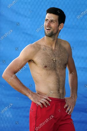 Novak Djokovic of Serbia reacts during a warm down following his singles match against Cristian Garin of Chile during day six of the ATP Cup tennis tournament at Pat Rafter Arena in Brisbane, Australia, 08 January 2020.
