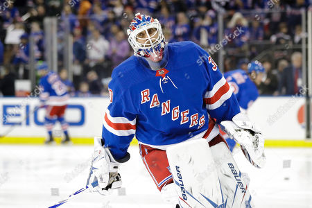 New York Rangers goaltender Henrik Lundqvist warms up before an NHL hockey game against the Colorado Avalanche, in New York