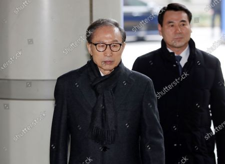 South Korea's former President Lee Myung-bak (L) arrives to attend a final hearing at the Seoul High Court in Seoul, South Korea, 08 January 2020. Lee, who was freed on bail from a detention center on 06 March 2019, is appealing a 15-year sentence for bribery, embezzlement and other acts of corruption.
