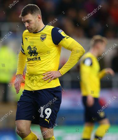 Jamie Mackie of Oxford United looks dejected