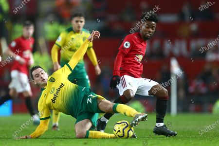 Norwich's Kenny McLean and Angel Gomes of Manchester United