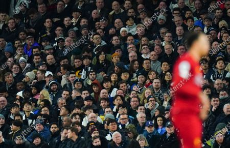 Fans look on behind Trent Alexander-Arnold of Liverpool