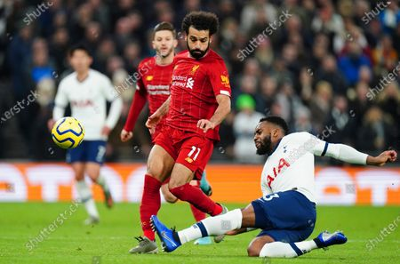 Danny Rose of Tottenham Hotspur tackles Mohamed Salah of Liverpool