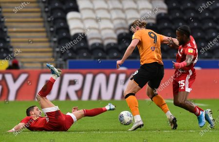 Stock Picture of Tom Eaves of Hull City holds off Anthony Knockaert and Joshua Onomah of Fulham