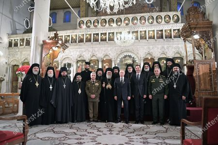 Syrian President Bashar Assad (front 3-R), Russian President Vladimir Putin (front 7-L), Greek Orthodox Patriarch of Antioch and All East John X Yazigi (R) and Russian Defense Minister Sergey Shoygu (2-R) during their visit to the Cathedral of the Blessed Virgin Mary in Damascus, Syria, 07 January 2020. Putin arrived in Damascus where he met with Assad, visited headquarters of the Russian forces and was briefed by the commander of the Russian forces operating in Syria.