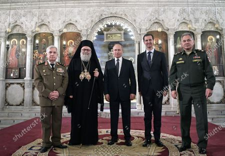 Syrian President Bashar Assad (2-R), Russian President Vladimir Putin (C), Greek Orthodox Patriarch of Antioch and All East John X Yazigi (2-L) and Russian Defence Minister Sergey Shoygu (R) during their visit Cathedral of the Blessed Virgin Mary in Damascus, Syria, 07 January 2020 (issued 08 January 2020). Putin arrived in Damascus where he met with Assad, visited headquarters of the Russian forces and was briefed by the commander of the Russian forces operating in Syria.
