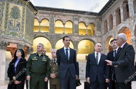 Syrian President Bashar Assad (C), Russian President Vladimir Putin (3-R) and Russian Defence Minister Sergey Shoygu (2-L)  during their visit Umayyad Mosque in Damascus, Syria, 07 January 2020 (issued 08 January 2020). Putin arrived in Damascus where he met with Assad, visited headquarters of the Russian forces and was briefed by the commander of the Russian forces operating in Syria.