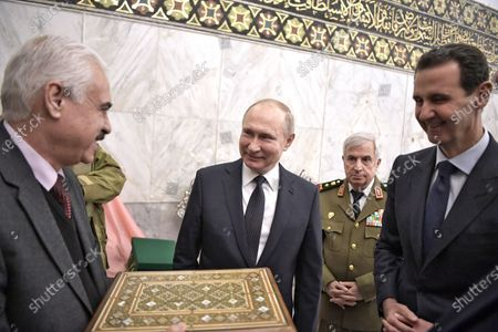 Syrian President Bashar Assad (R) and Russian President Vladimir Putin (C) during their visit Umayyad Mosque in Damascus, Syria, 07 January 2020 (issued 08 January 2020). Putin arrived in Damascus where he met with Assad, visited headquarters of the Russian forces and was briefed by the commander of the Russian forces operating in Syria.