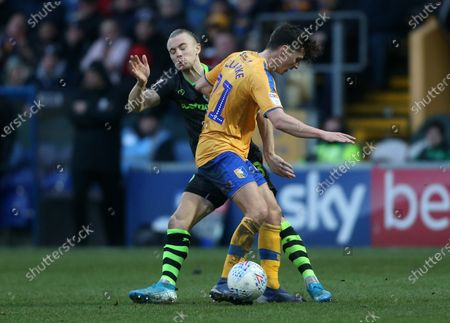 Mansfield Town's James Clarke battles with Joseph Mills of Forest Green Rovers