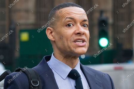 Labour Party leadership contender Clive Lewis walks outside The Houses of Parliament.