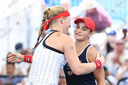 Stock Picture of Ashleigh Barty of Australia and Kiki Bertens of Netherlands embrace after winning their doubles match against Nicole Melichar of USA and Yifan Xu of China during the match between Samantha Stosur of Australia and Madison Keys of USA during day 3 of the Brisbane International tennis tournament at the Queensland Tennis Centre in Brisbane, 08 January 2020.