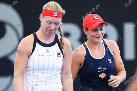 Stock Photo of Ashleigh Barty of Australia is seen with doubles partner Kiki Bertens in their doubles match against Nicole Melichar of USA and Yifan Xu of China during the match between Samantha Stosur of Australia and Madison Keys of USA during day 3 of the Brisbane International tennis tournament at the Queensland Tennis Centre in Brisbane, 08 January 2020.