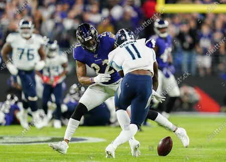 Stock Image of A.J. Brown, Wide Receiver of the Tennessee Titans (11) drops the ball as he is challenged by Jimmy Smith, Cornerback of the Baltimore Ravens (22)