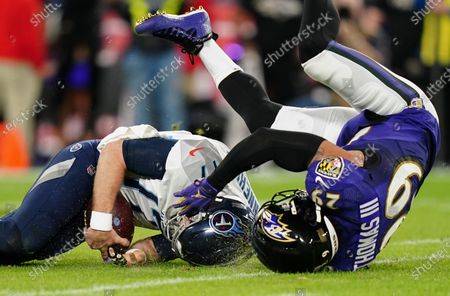 Ryan Tannehill, Quarterback of the Tennessee Titans (17), is sacked by Earl Thomas III, Safety of the Baltimore Ravens (29)