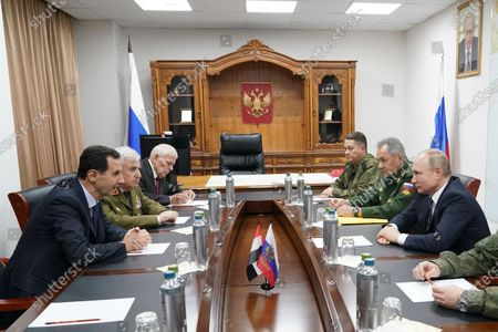 Syrian President Bashar al-Assad (1st L) holds a meeting with Russian President Vladimir Putin (1st R) in Damascus, Syria. Russian President Vladimir Putin arrived in Damascus on Tuesday and met with Syrian President Bashar al-Assad, state news agency SANA reported.