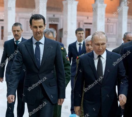 Syrian President Bashar al-Assad (L front) and Russian President Vladimir Putin (R front) visit the Umayyad Mosque in Damascus, Syria. Russian President Vladimir Putin arrived in Damascus on Tuesday and met with Syrian President Bashar al-Assad, state news agency SANA reported.