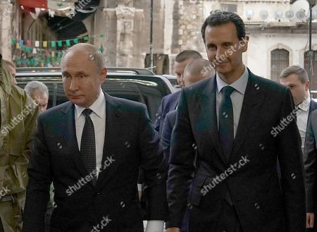 Russian President Vladimir Putin and Syrian President Bashar al-Assad meeting in Damascus. Putin met his Syrian counterpart Bashar al-Assad during an unprecedented visit to Damascus as the prospect of war between Iran and the United States loomed over the region.