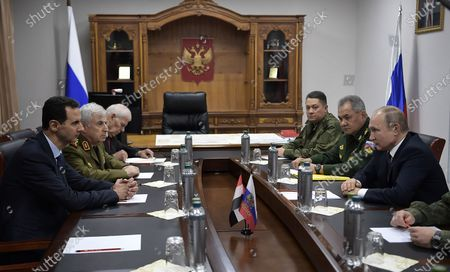 Stock Picture of President Bashar al-Assad (L) during a meeting with his Russian counterpart Vladimir Putin at the headquarters of the Russian forces in the Syrian capital Damascus. Putin met his Syrian counterpart Bashar al-Assad during an unprecedented visit to Damascus as the prospect of war between Iran and the United States loomed over the region.