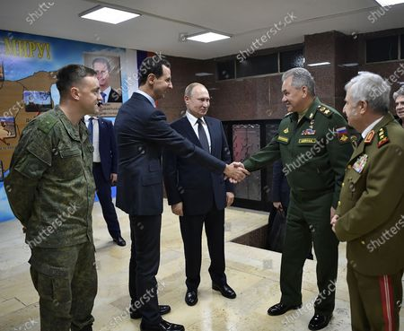 Stock Image of Syrian President Bashar al-Assad, Russian President Vladimir Putin and Defence Minister Sergey Shoygu attend a meeting in Damascus, Syria. Putin traveled to Damascus for a brief visit that comes amid soaring tensions between Iran and United States following the U.S. drone strike that killed a top Iranian general.