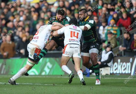 Northampton Saints Francois Van Wyk is tackled by Benetton's Marco Lazzaroni and Leonardo Sarto
