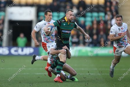 Northampton Saints Rory Hutchinson is tackled by Benetton's Leonardo Sarto