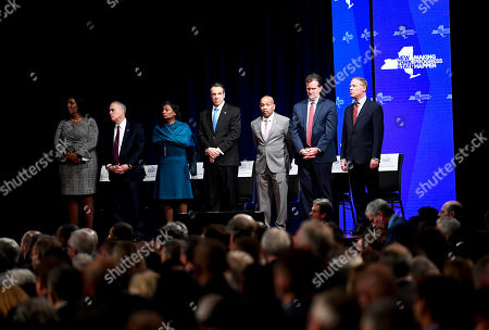 Stock Photo of Letitia James, Thomas DiNapoli, Andrea Stewart-Cousins, Andrew Cuomo, Carl Heastie, John Flanagan, Will Barclay. From left, State Attorney General Letitia James, State Comptroller Thomas DiNapoli, Senate Majority Leader, Andrea Stewart-Cousins, Gov. Andrew Cuomo, Assembly Speaker Carl Heastie, Senate Minority Leader John Flanagan and Assembly Minority Leader Will Barclay listen as Rabbi Chaim Rottenberg of Congregation Netzach Yisroel, speaks before New York Gov. Andrew Cuomo delivers his State of the State address at the Empire State Plaza Convention Center, in Albany, N.Y